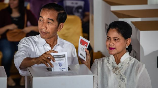President Joko Widodo pictured voting in the election with his wife, Iriana